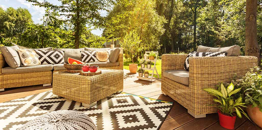 Garden furniture with Aztec style rugs and cushions