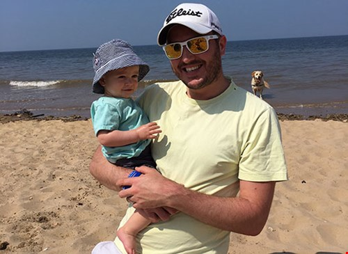 Steve Bland with his son on a beach