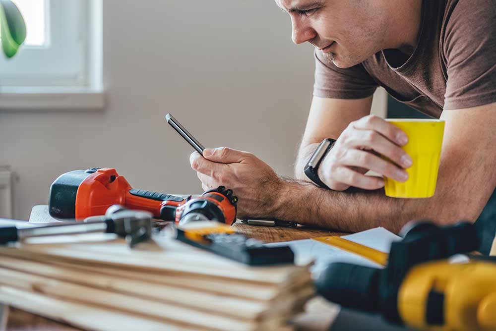 Man using device to help with DIY