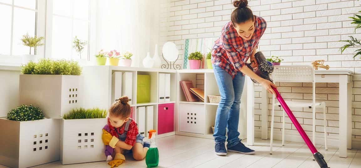 Woman cleaning with daughter
