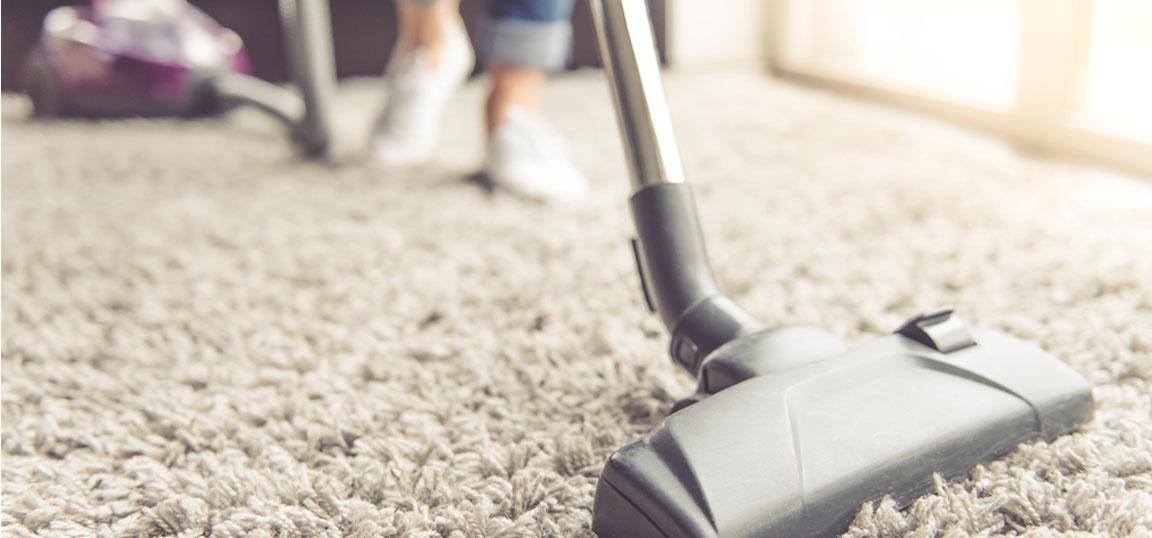 Woman hoovering carpet