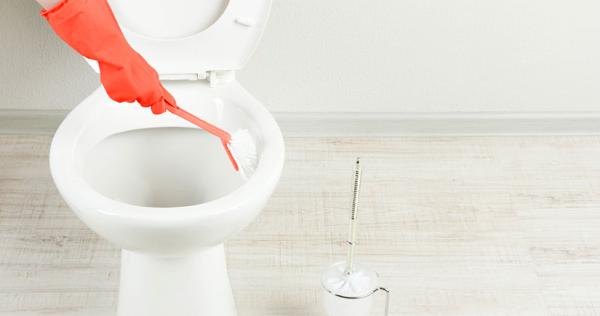 Red rubber glove cleaning toilet